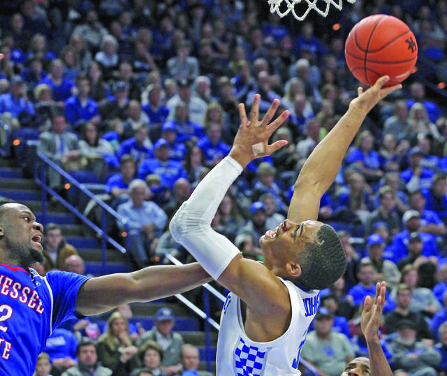 acb298d1e Kentucky's Keldon Johnson, right, is fouled by Tennessee State's Emmanuel  Egbuta during the second half in Lexington, Friday. (AP Photo/James Crisp) -