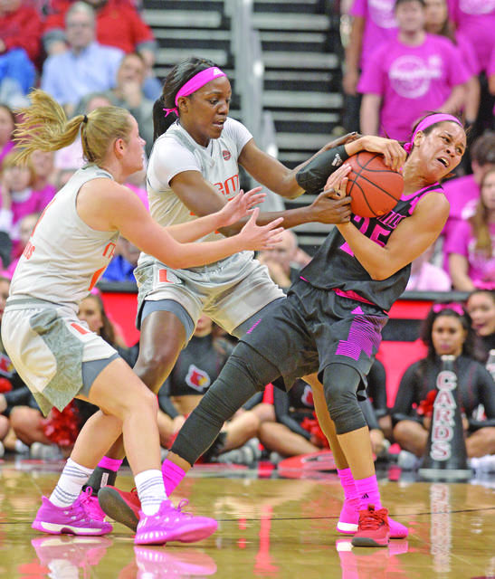 f69c1d9080e5 Louisville guard Asia Durr (25) battles Miami forward Khalia Prather (25)