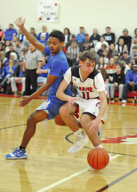 e73599be2 Eastern's Gage Boone (11) dribbles down the floor while being closely  guarded by Ripley's Nigel Royal, Tuesday, in Sardinia. The Warriors denied  Ripley a ...