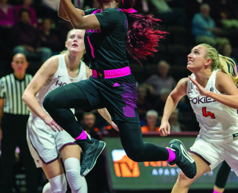 6af7205ff1754 ... Virginia Tech forward Regan Magarity, left, and Dana Mabrey, right,  during the first half of an NCAA college basketball game Sunday, in  Blacksburg, Va.