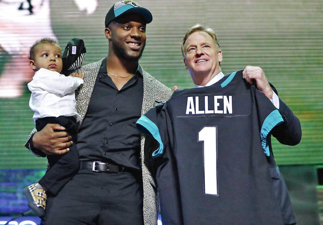 6e6ca7c4 Kentucky linebacker Josh Allen poses with NFL Commissioner Roger Goodell  after the Jacksonville Jaguars selected Allen in the first round at the NFL  ...