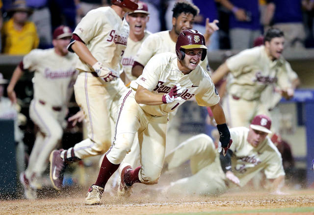 online store a7317 1b14e Florida State s Mike Salvatore reacts after crossing home plate to score  the winning run against LSU in the 12th inning of Game 2 of the NCAA  college ...