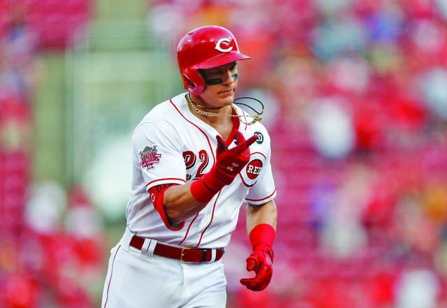 98cce028d Cincinnati Reds' Derek Dietrich (22) points as he rounds the bases with a  two-run home run off Pittsburgh Pirates starting pitcher Jordan Lyles  during the ...