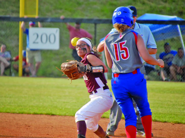 ed9f231e6ab Ashland Blazer's Maddy Greene (left) attempts to turn a double play after  getting Lewis County's Emily Short (right) out at second base during the  fourth ...