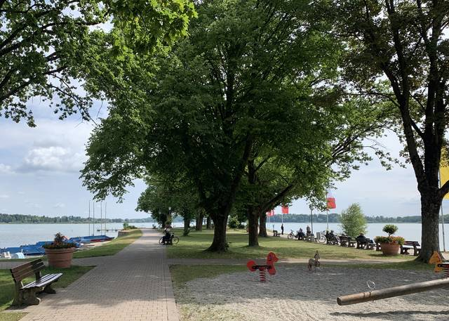 <p>Walkways to the water offer playgrounds for the young and benches for others who just want to relax near Chiemsee.</p>