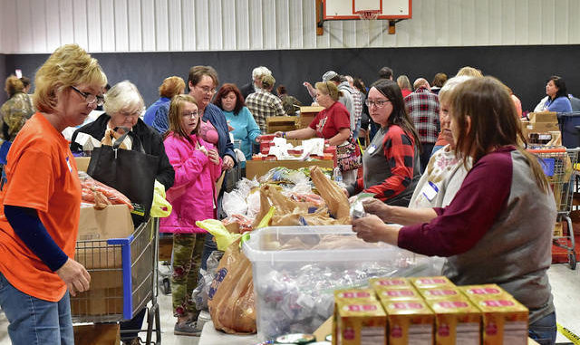 Many volunteers assist with a food distribution program at the May's Lick Baptist Church.