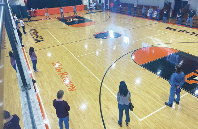 AIS staff and community came together for a prayer circle on Friday.
