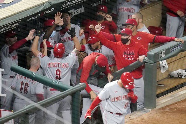 Reds clinch playoff spot with win over Twins