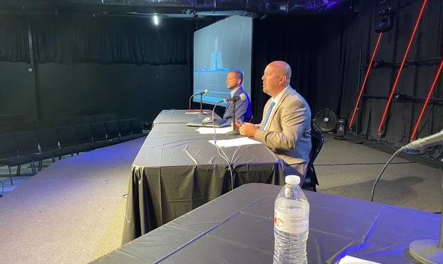William Lawrence, left, and Craig Miller, answer questions during Thursday's candidate forum. Both men are candidates for the 70th Kentucky House District seat now held by John Sims Jr.