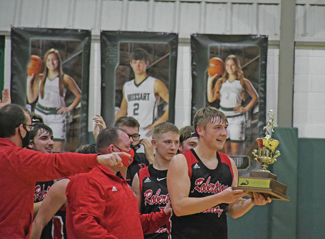 "Robertson County's Justin Becker receives the 10th Region All ""A"" Championship trophy after Thursday night's game. (Evan Dennison, The Ledger Independent)"