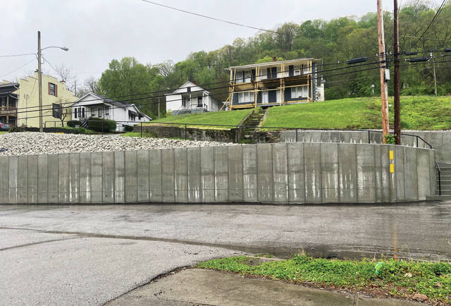 This retaining wall on Fourth Street will soon contain murals honoring the city's African American leaders.