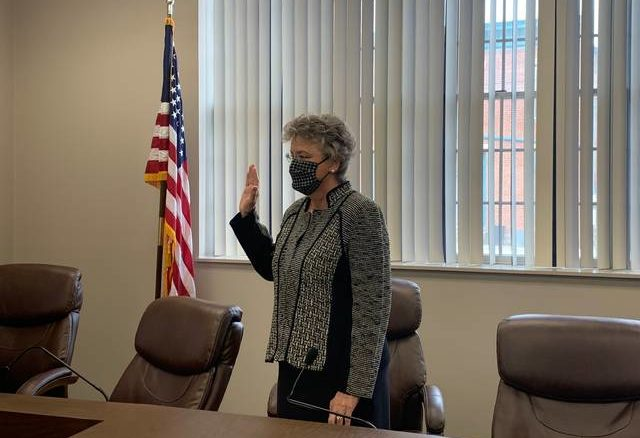 Debra Cotterill takes the oath of office as Maysville mayor. She was named Thursday to fill the seat left vacant by her husband's death early this month.