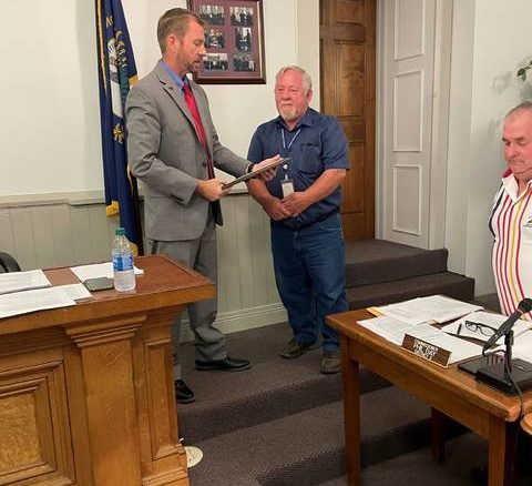 Mason County Judge-Executive Owen McNeill presents the Mason County Pioneer Award to Larry Brewer, who will be retiring from the Mason County School District on June 30.                                  Provided