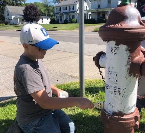 RULH students and community members recently painted fire hydrants the village.                                  Submitted