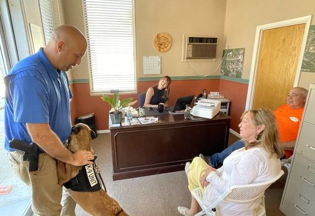 Vanceburg Police Officer Tony Carrington shows off the new city drug dog, Elle, to Lewis County residents Joni Pugh, Cary Cagle and Tara Blevings.