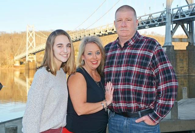 Joey Greenwell (right) poses with his wife, Melissa Greenwell (middle) and their daughter, Emily Greenwell (left).